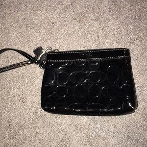 Patent leather black coach wristlet